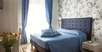 Domus Laurae - Roma - Habitación