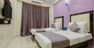 Om Sai Residency - מומבאי - חדר שינה