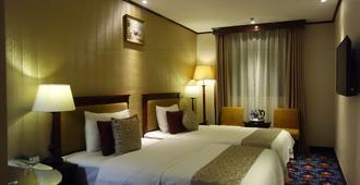 Macau Masters Hotel - Macau - Schlafzimmer