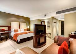 Protea Hotel by Marriott Transit O.R. Tambo Airport - Johannesburg - Bedroom