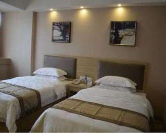 Super 8 Hotel Ningde Gutian East Bus Station - Hubin - Bedroom