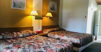 Polson Park Motel - Vernon - Bedroom