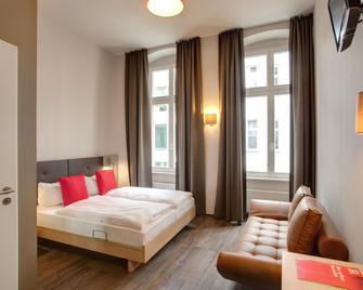 Meininger Hotel Berlin Mitte Humboldthaus - Berlino - Camera da letto