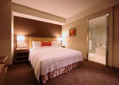 هارموني هوتل - مدينة كاوهسيونغ - غرفة نوم