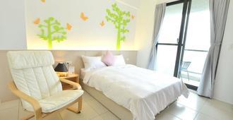 Slow Life Bed and Breakfast - Hengchun - חדר שינה
