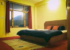 Red House Cafe Manali - Manali - Schlafzimmer