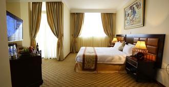 Caravan Hotel - แอดดิสอาบาบา - ห้องนอน