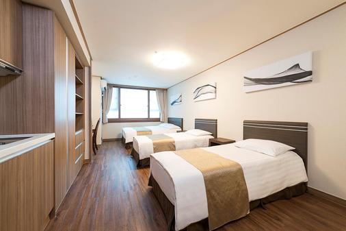 西方高爺飯店&公寓東大門 - 首爾 - 臥室