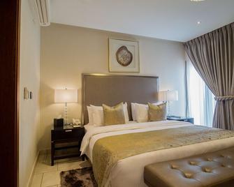 Oak Plaza Suites - Kumasi - Schlafzimmer