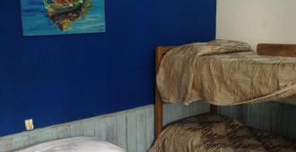 Hospedaje Los Pinos - Puerto Iguazú - Bedroom
