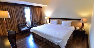 New Season Hotel - Hat Yai - Schlafzimmer
