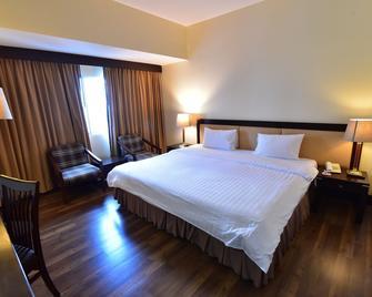 New Season Hotel - Hat Yai - Κρεβατοκάμαρα