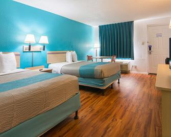 Motel 6 Ocala Conference Center - Окала - Спальня