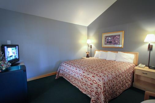 Moose Creek Lodge & Suites - Cody - Schlafzimmer