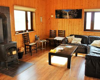 Fossatun Camping Pods & Cottages - Sleeping Bag Accommodation - Borgarnes - Living room