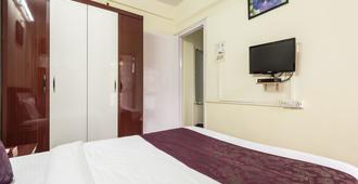 Oyo 1724 Shivam Apartment - Mumbai - Slaapkamer
