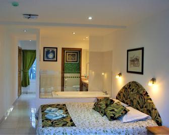 Familia Piatti Suites - Ushuaia - Bedroom