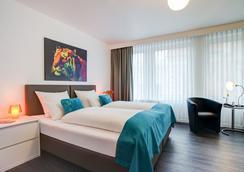 Atlanta Hotel Central - Hannover - Schlafzimmer