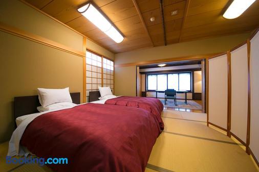 Yufuin Onsen Ryotei Tanokura - Yufu - Bedroom