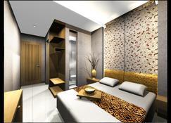 Hotel Neo Cirebon By Aston - Cirebon - Habitación