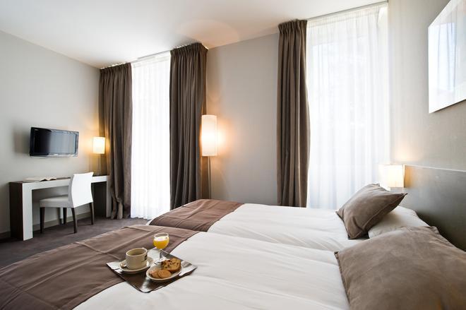 基里亞德奧蘭奇中央酒店 - 歐宏吉 - 奧蘭治 - 臥室