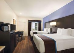 Days Inn & Suites by Wyndham Galveston West/Seawall - Galveston - Bedroom