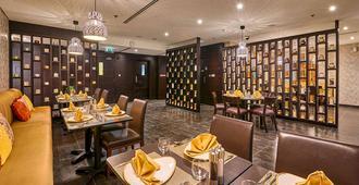 Ramada Hotel and Suites by Wyndham Dubai JBR - דובאי - מסעדה