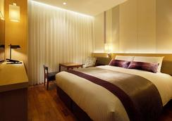 Mitsui Garden Hotel Osaka Premier - Осака - Спальня