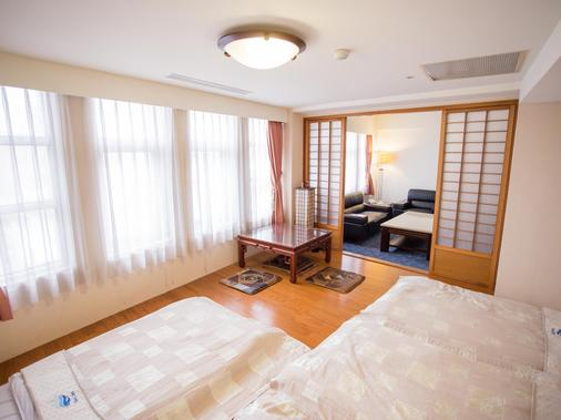 East Coast Hotel - Hualien City - Κρεβατοκάμαρα