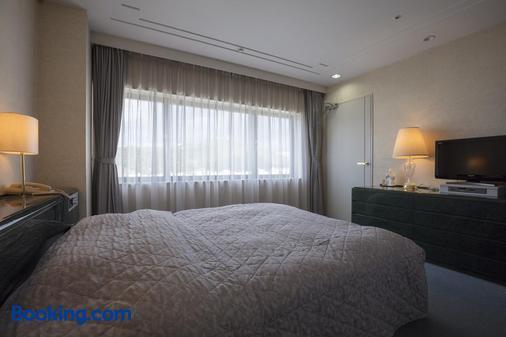 Century Plaza Hotel - Tokushima - Bedroom