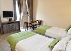Hotel Jataka Inn - Бодх-Гая - Спальня