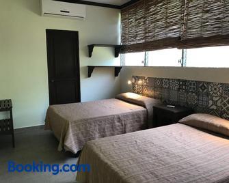 Hotel & Bar La Guitarra - El Sunzal - Habitación