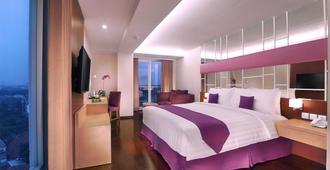 Quest Hotel Darmo - Surabaya By Aston - Surabaya - Bedroom
