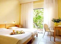 Hanioti Hotel - Chaniotis - Bedroom