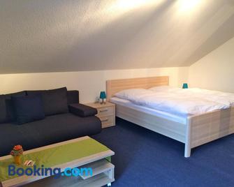 Das Gästehaus Eimeldingen - Binzen - Schlafzimmer