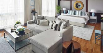 Mövenpick Hotel & Apartments Bur Dubai - דובאי - חדר שינה