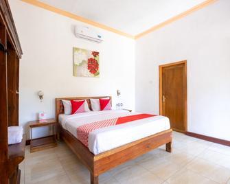OYO 1259 Kuta Garden Homestay - Kuta - Bedroom