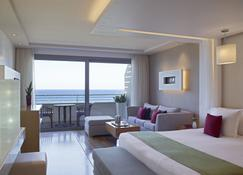 Elite Suites by Amathus Hotel - Rodos - Sypialnia