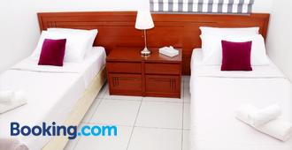 Tropicana Hotel - Manama - Schlafzimmer
