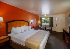 Travelodge by Wyndham Houston Hobby Airport - Houston - Phòng ngủ