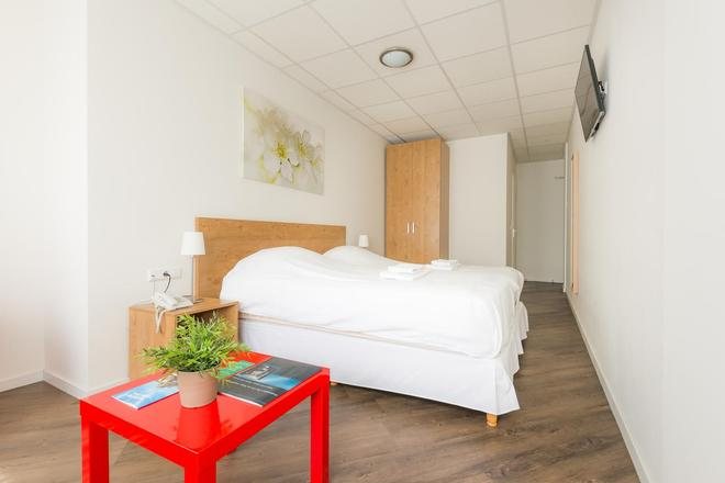 Joops City Centre Hotel - Haarlem - Phòng ngủ