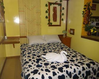 Cocopele Inn - Сан-Игнасио - Спальня