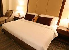 The Imperial Hotel & Convention Centre Korat - Nakhon Ratchasima - Schlafzimmer