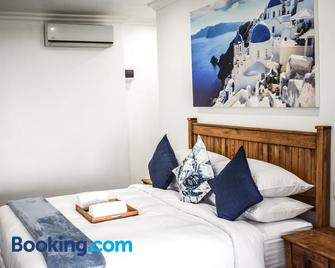 Santorini Guesthouse - Amanzimtoti - Bedroom