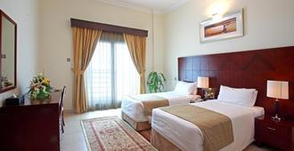 Rose Garden Hotel Apartments Barsha - דובאי - חדר שינה