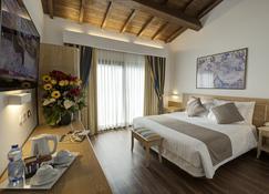 โรงแรมโอโรลอโจ - เฟอรารา - ห้องนอน