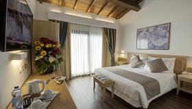 Hotel Orologio - Ferrara - Camera da letto