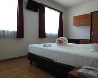 호텔 가르니 알 마리나이오 - 트렌토 - 침실
