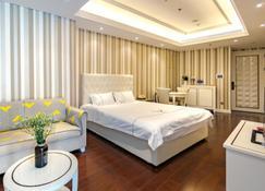 Xiamen Twin Tower Sea View Apartment - Xiamen - Habitación