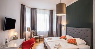 Kleines Hotel Heimfeld - Гамбург - Спальня